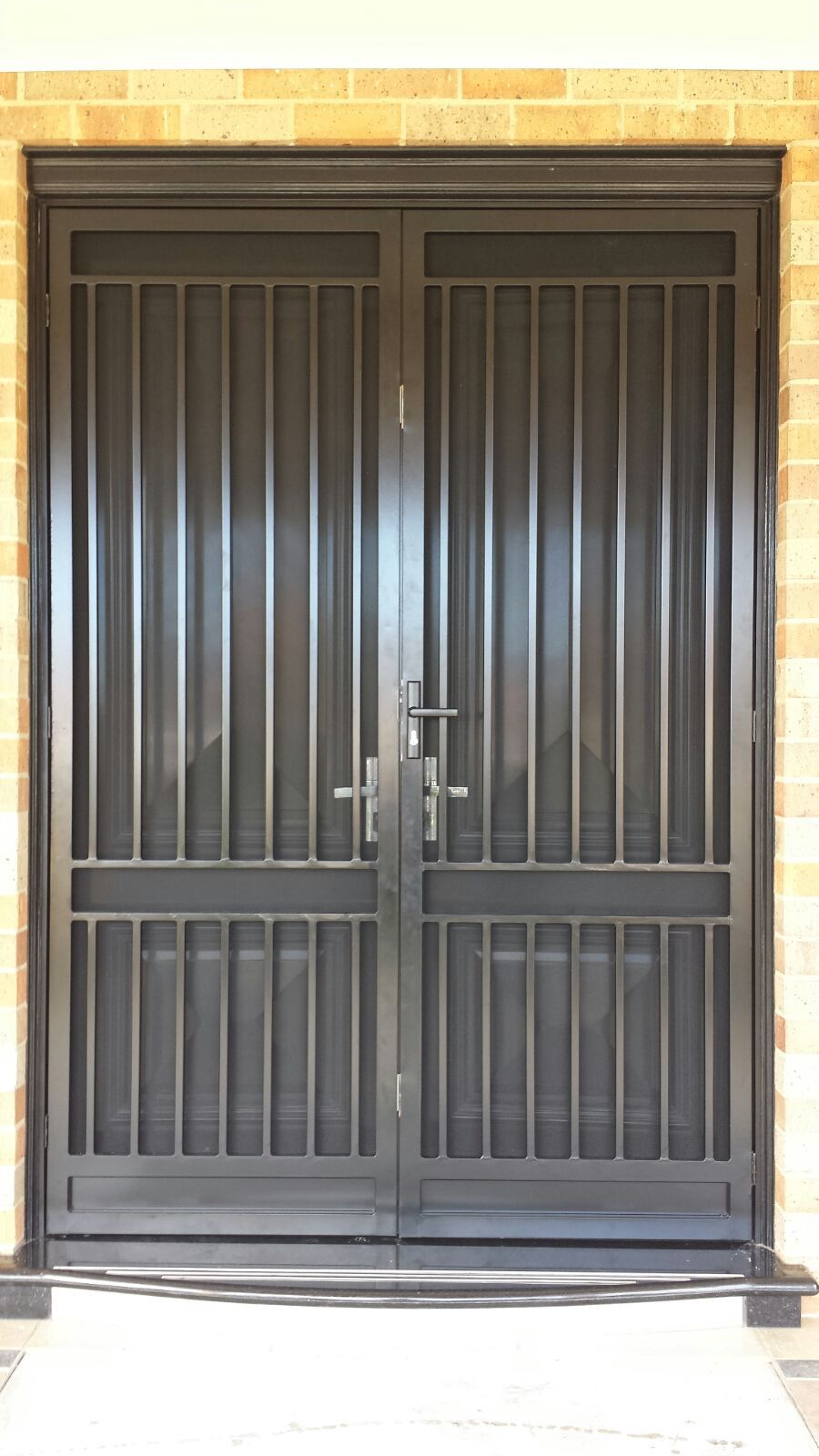 Custom Designed Steel Security Double Doors With Stainless Steel Mesh And Triple Locks Installed In Beau Steel Doors Steel Security Doors Double Front Doors