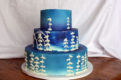 Blue wedding cake with mountains and trees