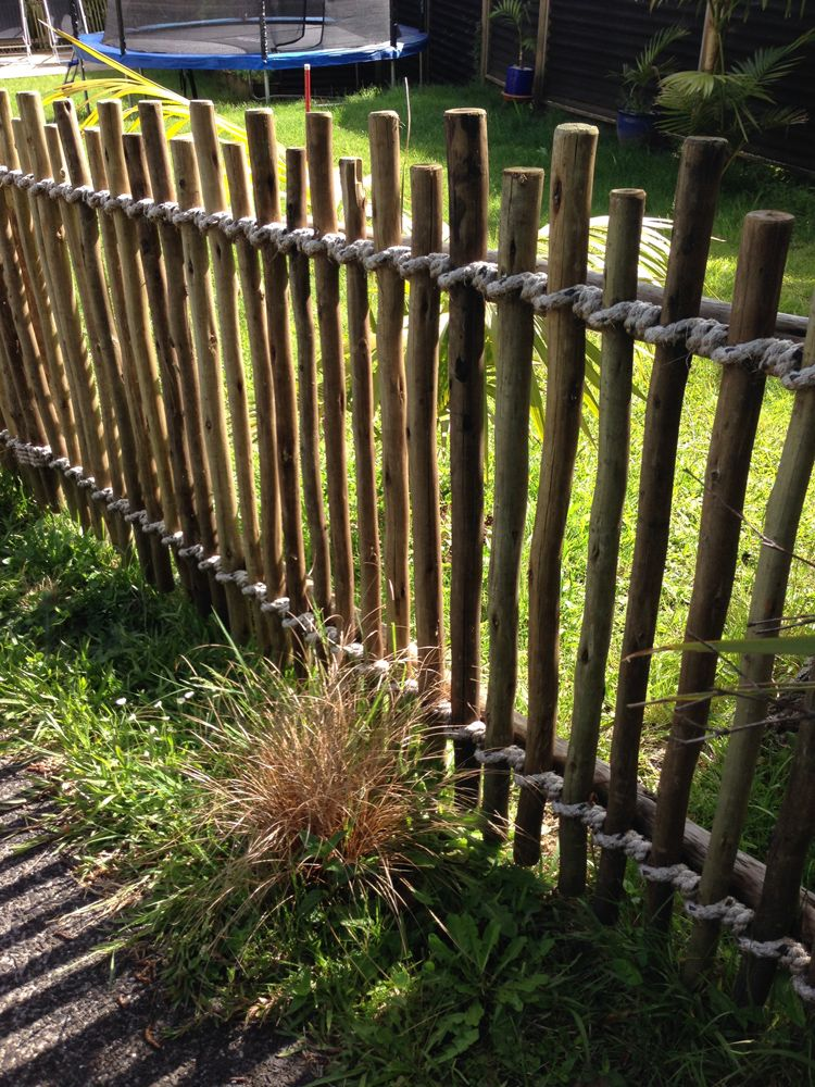 Casual Fence Made From Smooth But Irregular Sticks Bound With Rope