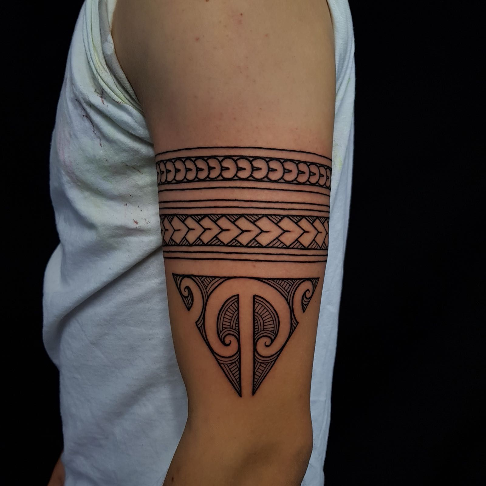 Maōri tattoo arm bands with a traditional Ta Moko triangle