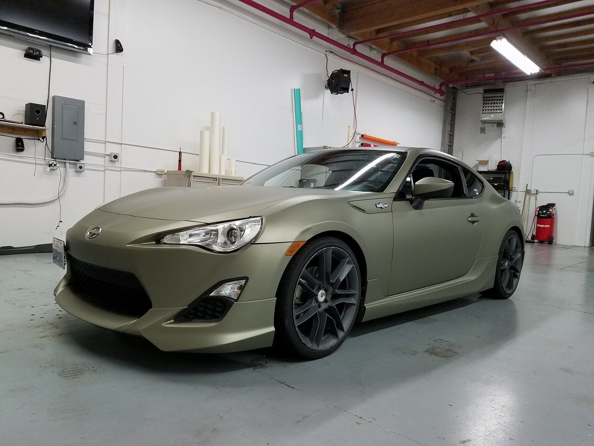 Full color change wrap on scion frs in matte metallic midnight sand avery dennison