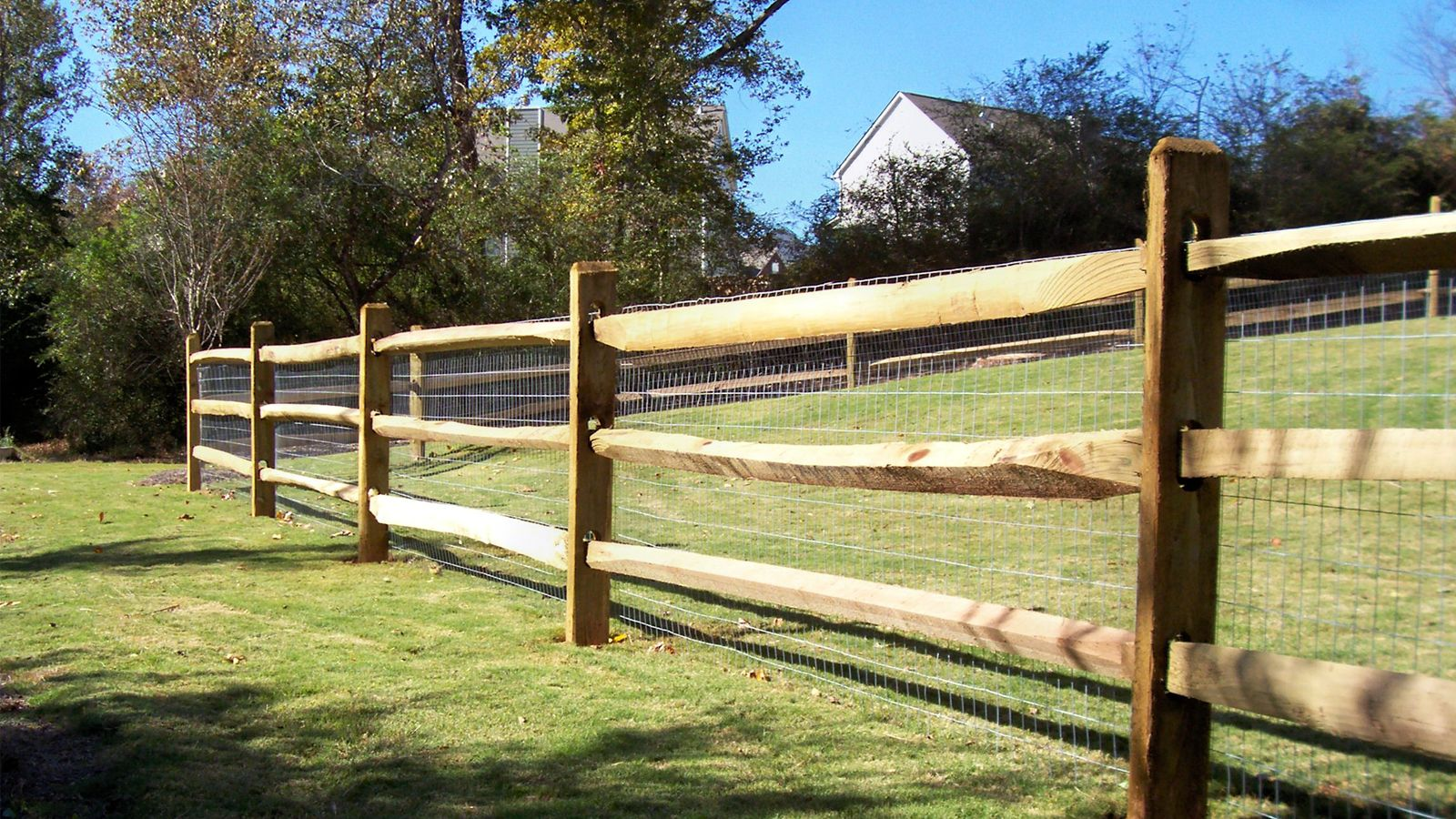 Custom wood horse fence design with wire for added protection custom wood horse fence design with wire for added protection mossy oak fence company baanklon Gallery