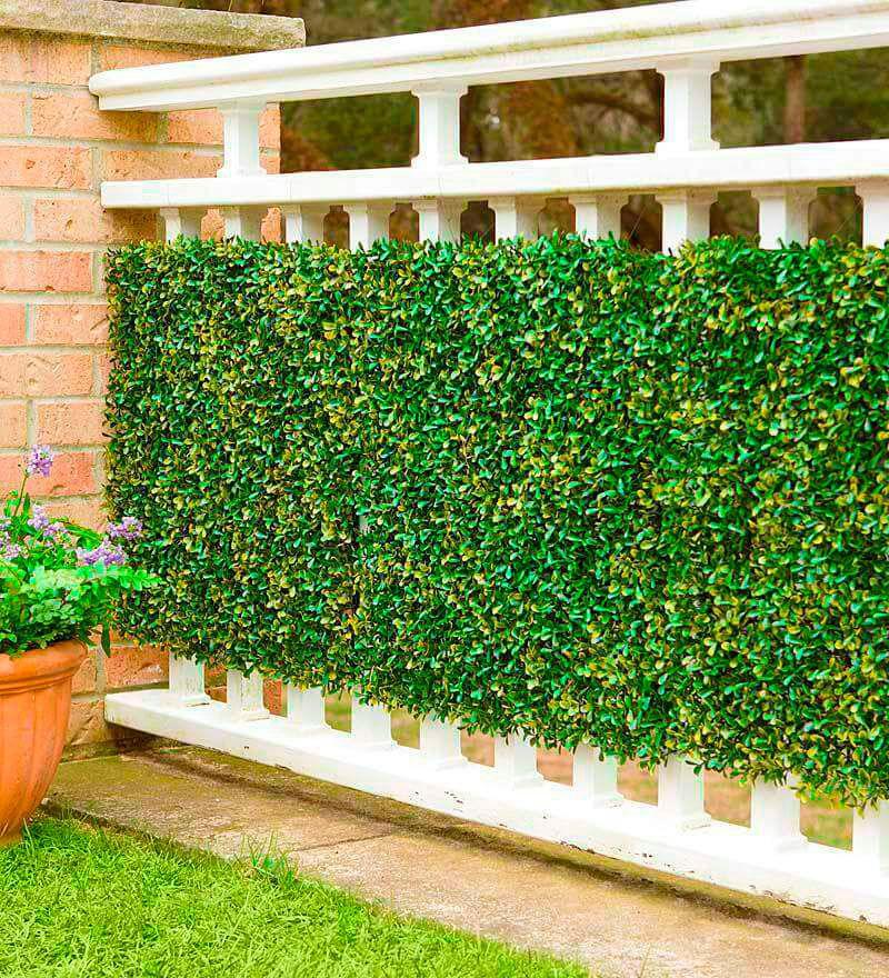Muros verdes pasto sintetico y follaje artificial san for Muros y fachadas verdes jardines verticales