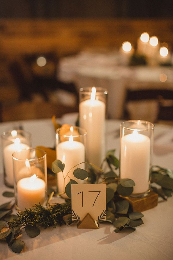 To create a really clean, modern aesthetic, use simple glass holders around small centerpieces or swaths of eucalyptus leaves. The result is minimalist magic!
