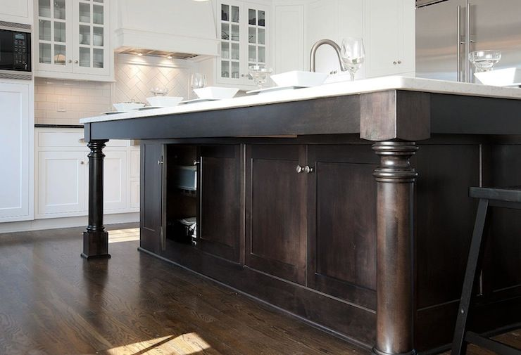 Fabulous Detail Of Espresso Stained Kitchen Island With Turned Wood Leg  Supports And White Granite Countertops.