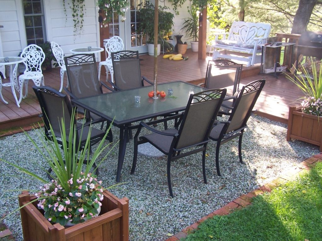 Garden Furniture On Gravel use our recycled glass under your patio table;cheaper than pavers