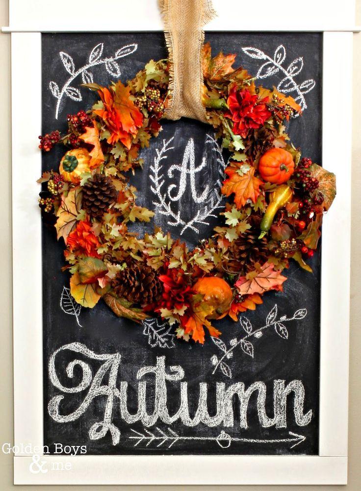 fall wreath displayed on chalkboard with autumn chalk art www goldenboysandme com