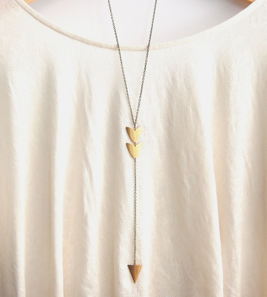 Long arrow brass pendant necklace hit the jewelry bullseye with this long pendant necklace it features a trio of brass mozeypictures Gallery