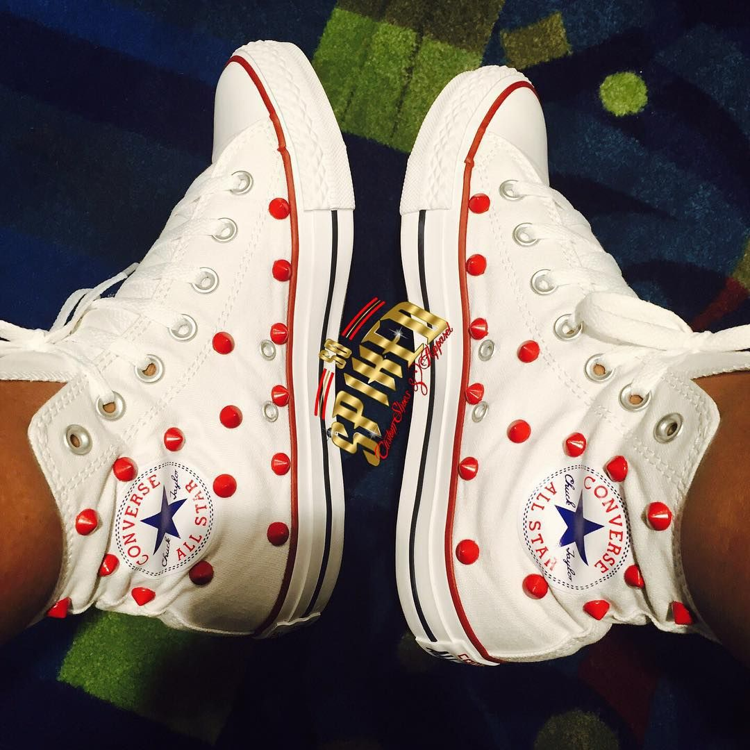 White/ red studded converse