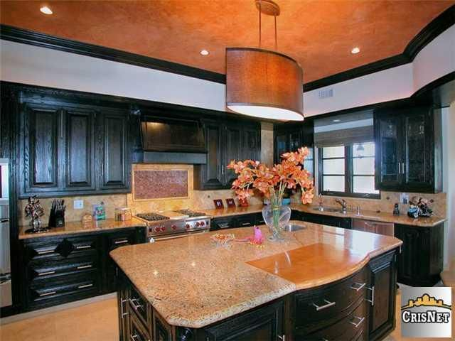 Khloe and Lamar's kitchen. Black cabinets with grain ...