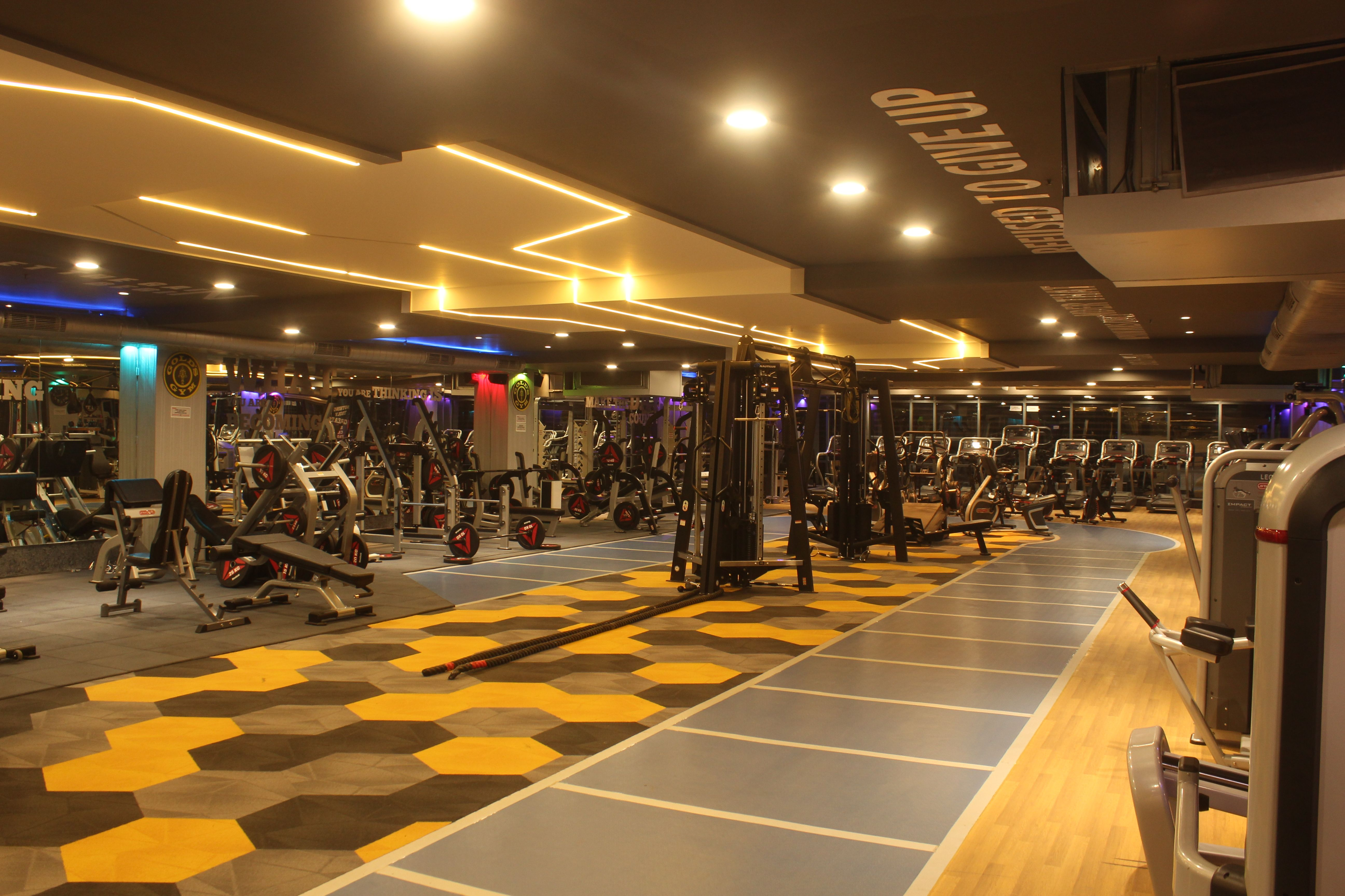 Workout at premier fitness center golds gym banjara hills