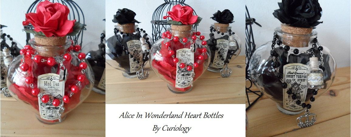 WANT!!! Alice in Wonderland pretty heart bottles with petals and pearls, red, white or black.. £17.50, via Etsy.