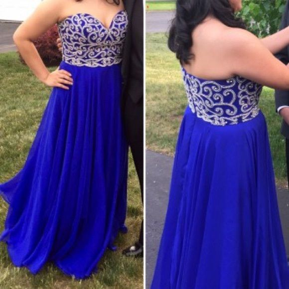 $250 SHERRI HILL PROM DRESS WORN ONCE Dress only worn once to prom.Designer categorizes this dress as purple but it comes off more like a blue. It's purple though in darker lighting. Has very beautiful beading on the top. I paid $600 and had it altered to fit my height since I'm 5'2. Sherri Hill runs small to begin with so my prom dress size was different to dresses I usually get. It is very comfortable&good for someone with a bigger bust like me. The length of the dress fits my height…