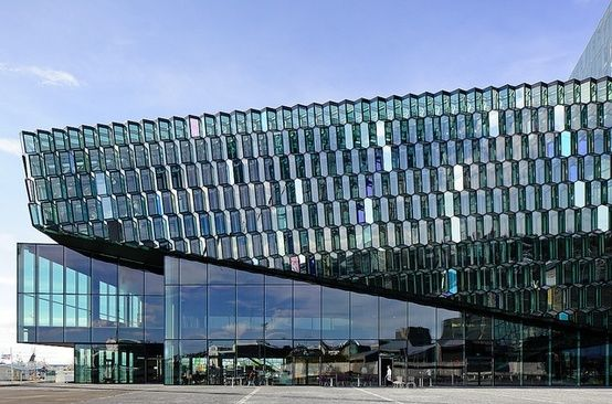 Glass facade architecture  Glass facade by Olafur Eliasson on the Harpa Concert Hall and ...