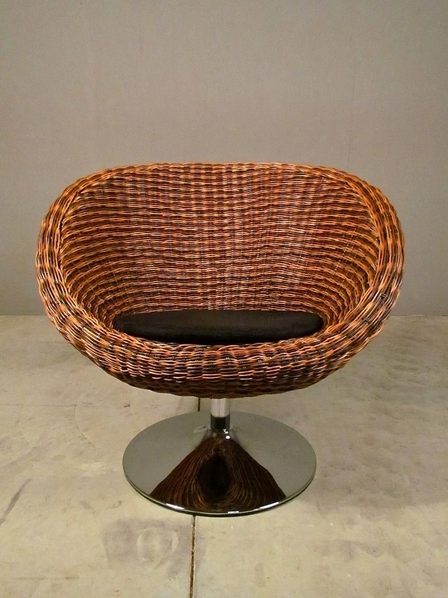 textured perfection  begin with the woven rattan body, the rising + falling of wicker layers + color. slide your eyes down the pedestal, gliding from post to floor in one fluid motion. you're looking at texture pairing at it's best.  then have a seat.  this mid-century scaled swivel chair is supportive, comfortable + cushioned just where you would hope it might be. it fits small + medium bodies as beautifully as it will suit your modern, transitional, romantic or monochromatic decor. we l…