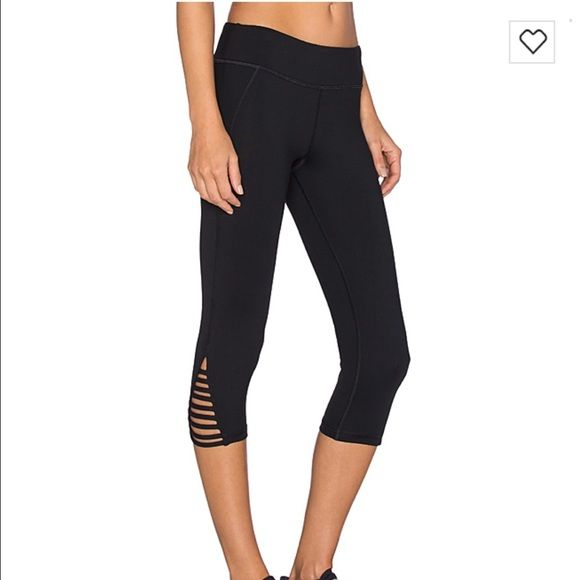 Trina Turk leggings Strapped solids mid length leggings in black Trina Turk Pants Leggings
