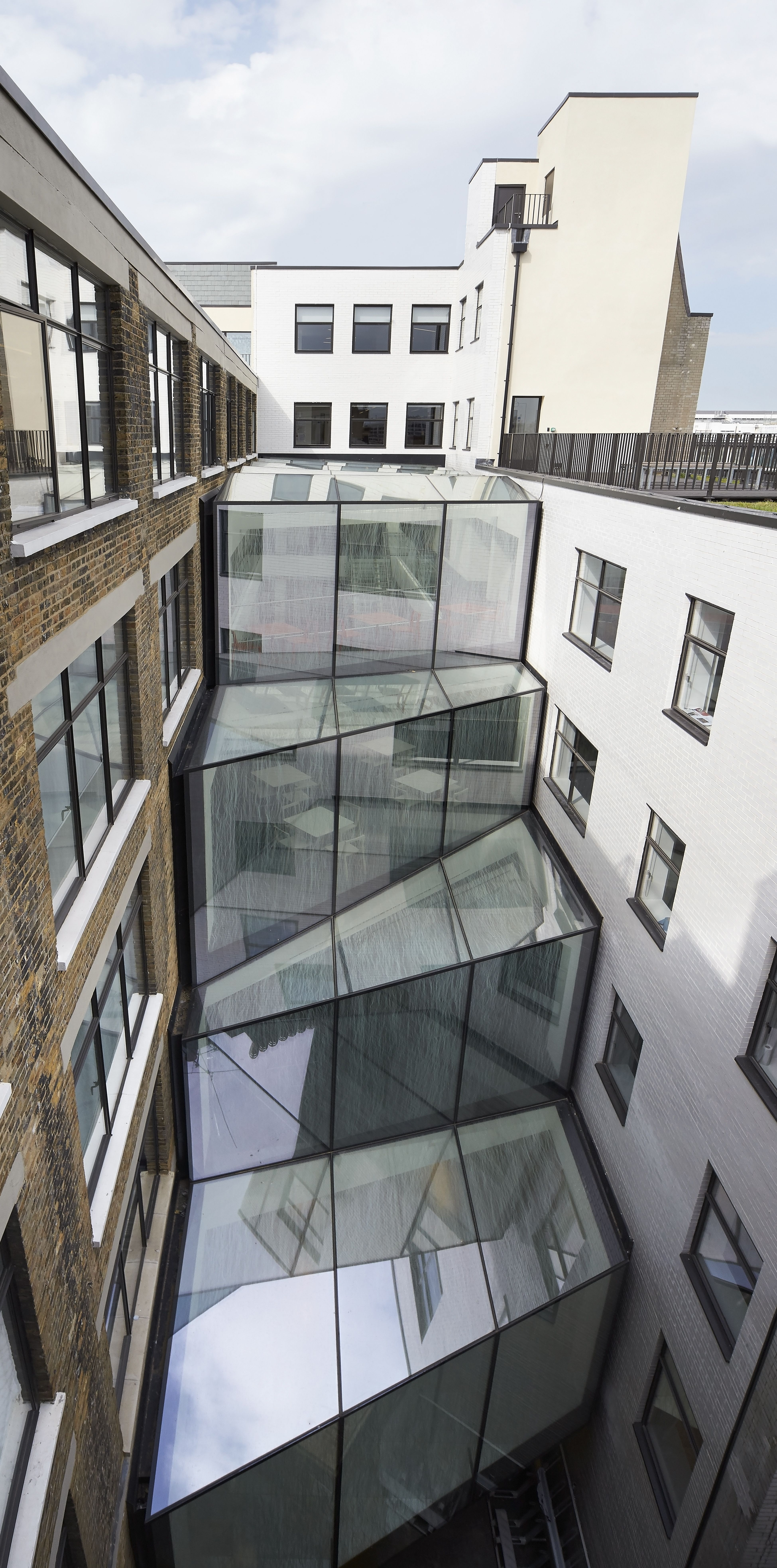 The Unique New Atrium On This Office Development Provides A Physical Link  Between An Old Building Nice Ideas