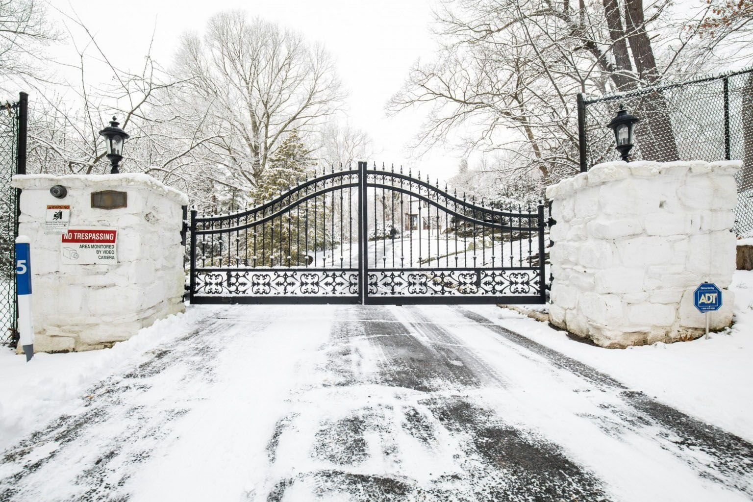 A Traditional Wrought Iron Driveway Gate Design In Black Creates