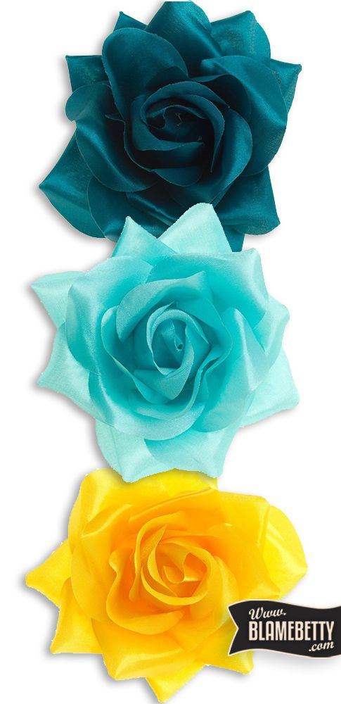 Complete any classic pin-up look with these Satin Hair Flowers in many different colours!