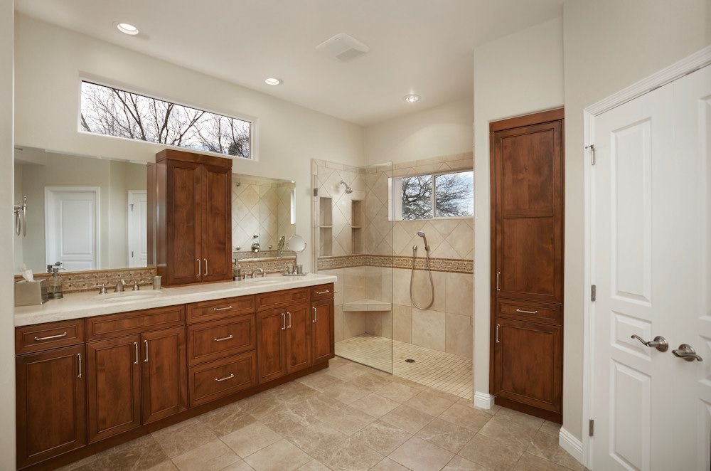 heated tile flooring with a tile rug in front of vanity shower tiles inset with a border of 2x2 floor tiles full tile shower walls ceiling and