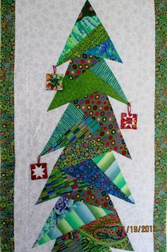 """Kaffe Fassett Christmas tree wall hanging by Shelley at Waterwheel House Quilt Shop: paper pieced  """"Tall Trim the Tree"""" pattern by Cindi Edgerton ( 76"""" tall!)"""