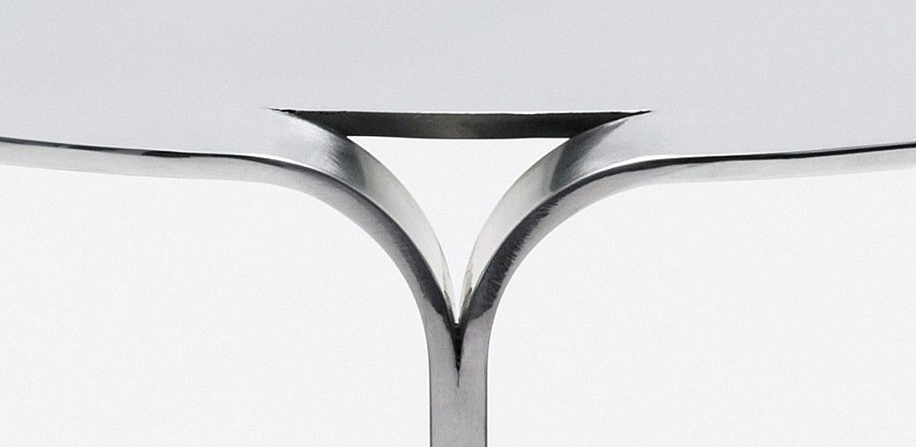 Sleek Table Crafted From A Single Sheet Of Aluminum
