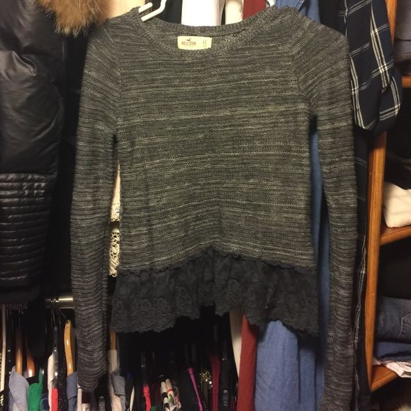 Lace trimmed sweater Beautiful sweater that's on the cropped side with a lace trim. Hollister Tops