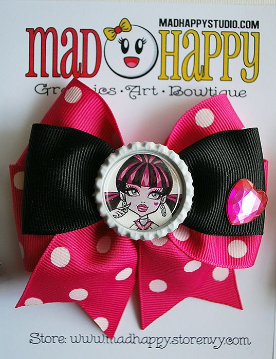 4 inch double bow. Comes with a double prong hair clip attached to back. A french barrette clip can be substituted instead upon request.  Perfect for any Monster High fan!