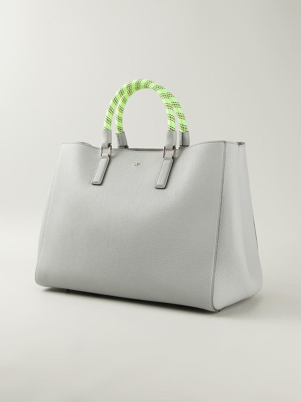 http://www.farfetch.com/mx/shopping/women/anya-hindmarch-large-side-smiley-featherweight-ebury-tote-item-10930659.aspx?storeid=9516