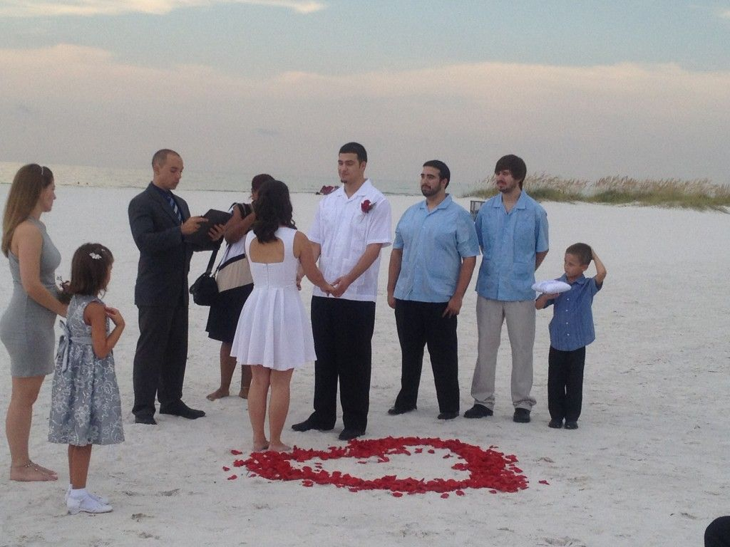clearwater beach sunset wedding spanish ceremony rose petal heart in sand non denominational