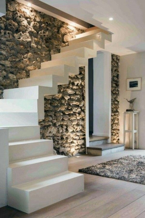 love the clean white concrete stairs in front of the rough textured stone wall enclosure. Black Bedroom Furniture Sets. Home Design Ideas