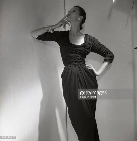 Black Fashion Models Poses: Model Barbara Mullen Leans Against Wall And Poses