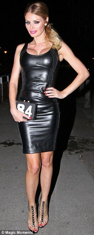 Working it  Chloe wore a tight latex black dress which showed off her  impressive cleavage. 4dce4ba9572