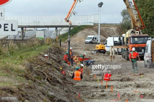 CALAIS, FRANCE - SEPTEMBER 26: Workers dig foundations of a wall... #montbriodecamp: CALAIS, FRANCE - SEPTEMBER 26:… #montbriodecamp