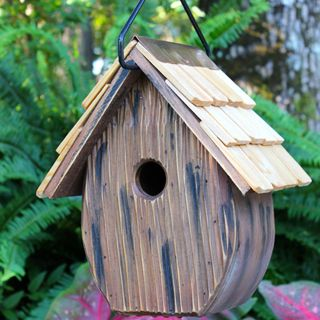 The Windy Willows Birdhouse is a great way to enhance you yard by nesting songbirds.