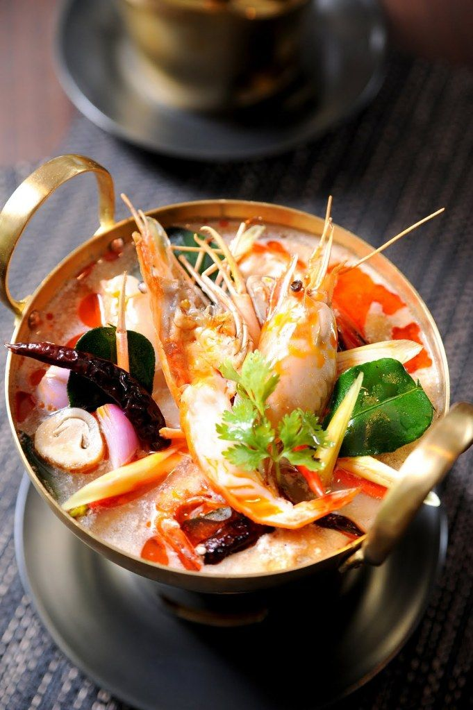 One of the most recognizable and noted dishes in Thai cuisine is Tom Yam — a hot and sour soup most often prepared with shrimp (Tom Yam Koong), with other popular variations including mushrooms (Tom Yam Het). The red-tinted broth represents a perfect example of the art of Thai cuisine, where the sensations of spicy, sour, sweet, and salty are delicately balanced....Read more : http://www.blog.luxuryvillasandhomes.com/tom-yamdeconstructed/