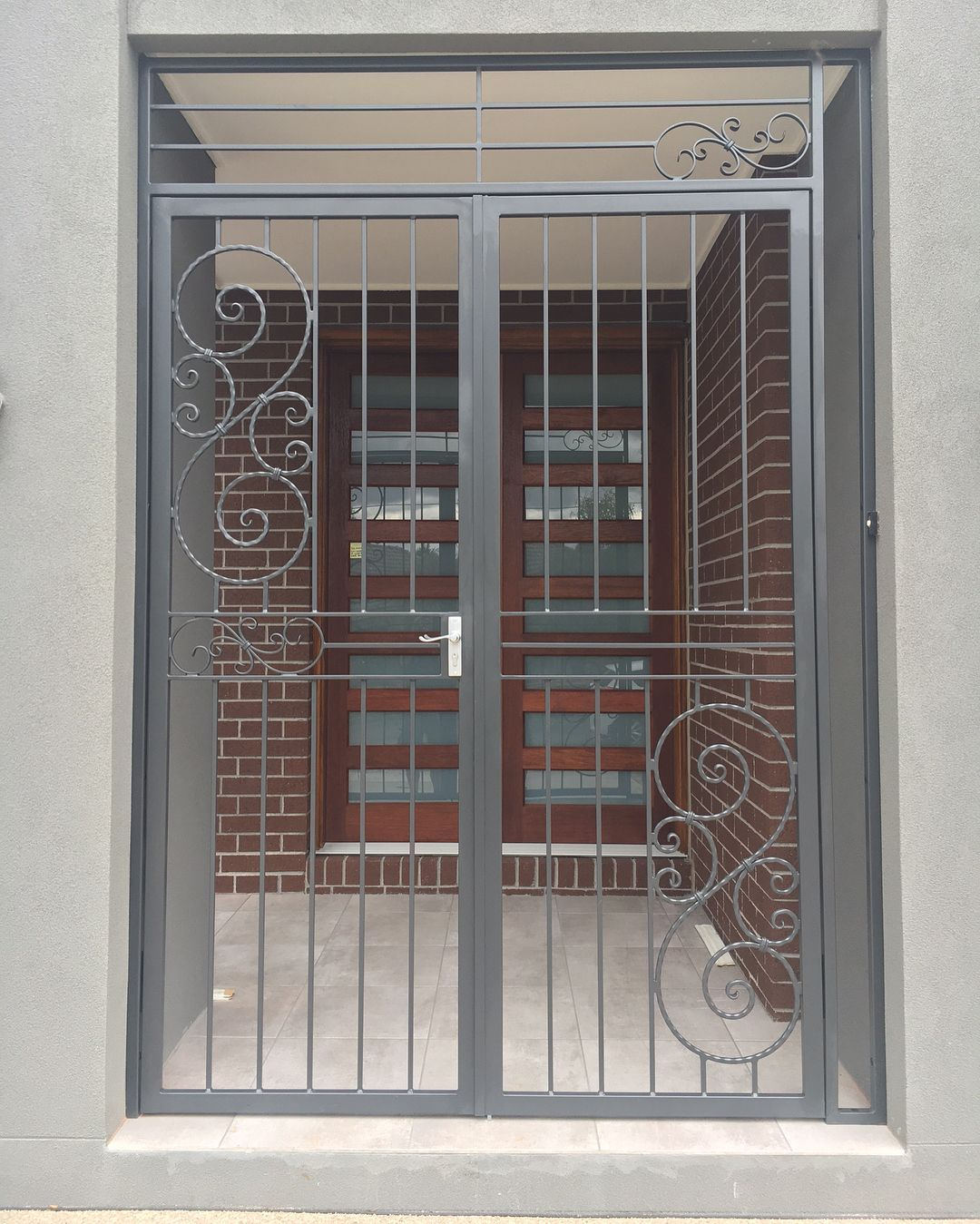 Custom Design Wrought Iron Security Gates Installed On The Alcove