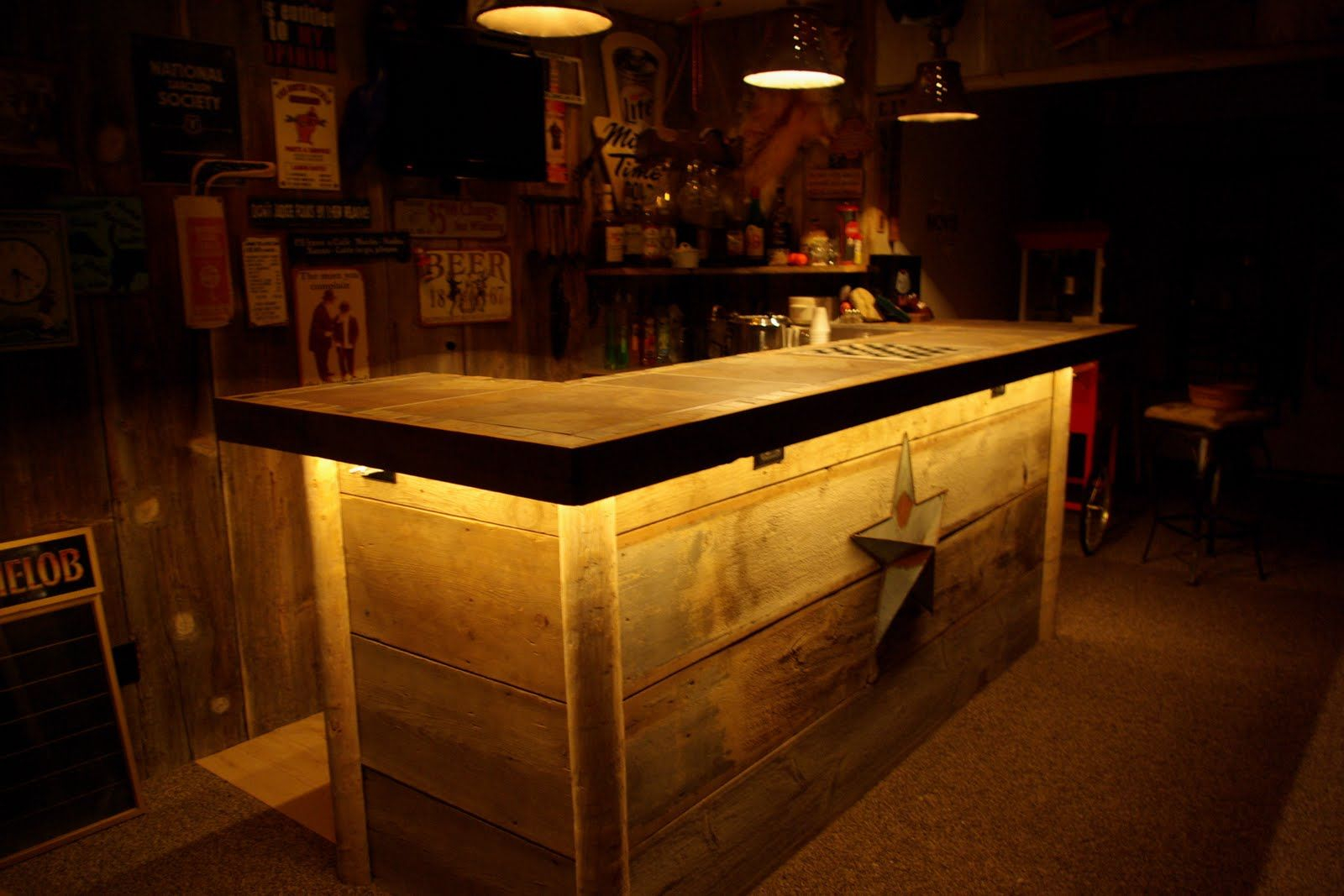 This basement Barn Wood Wet Bar was custom built on site and is the focal  point