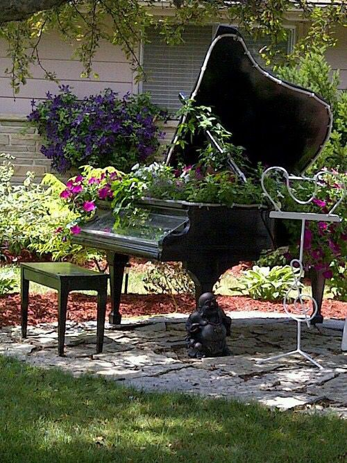 Piano With Plants In Garden