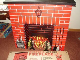 retro cardboard fireplace - Bing Images. We had one of these when I was a kid!! I loved hanging my stocking on it!