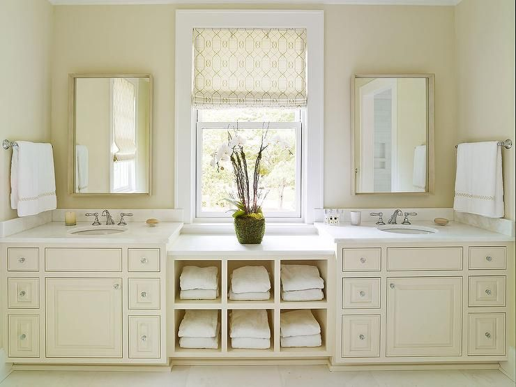 Cream Bathroom Features A Built In Shelving Unit Filled With