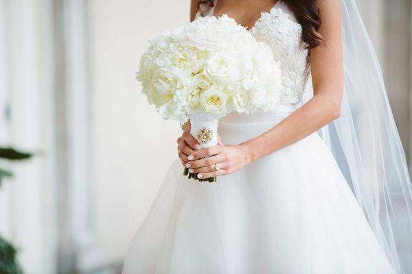 White Rose, Ranunculus & Peony Bouquet     Photography: Rob and Wynter Photography.   Read More:  http://www.insideweddings.com/weddings/mlb-players-white-black-gold-nye-ballroom-wedding-in-atlanta/806/