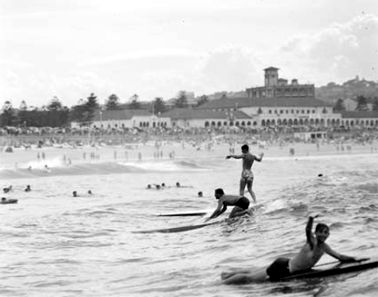 Surfers at Bondi displaying the old Australian style of surfing 1950 NAA