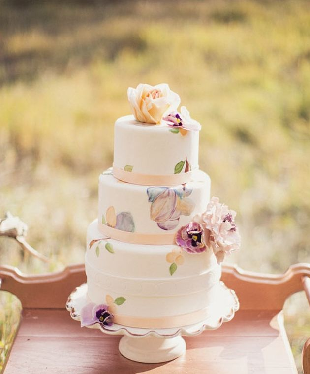 Oh-so-pretty!  I love the lace overlays, they look really opulent, and the hand-painted cake is just gorgeous.