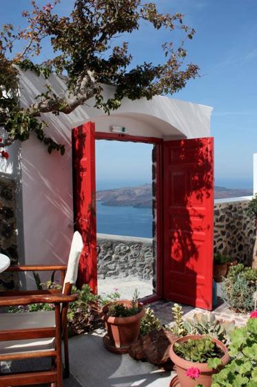 Santorini island - Greece - Red door with morning coffee