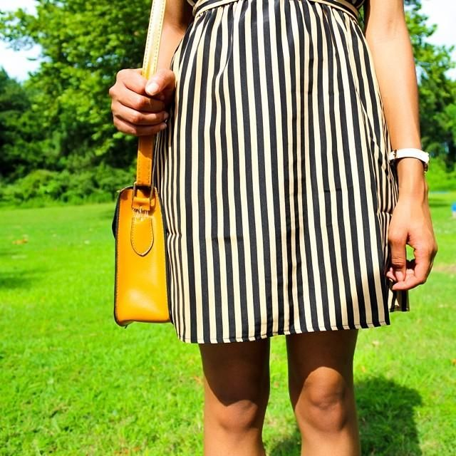 Precious C. pairs graphic stripes with bold hues for a perfectly punchy look.