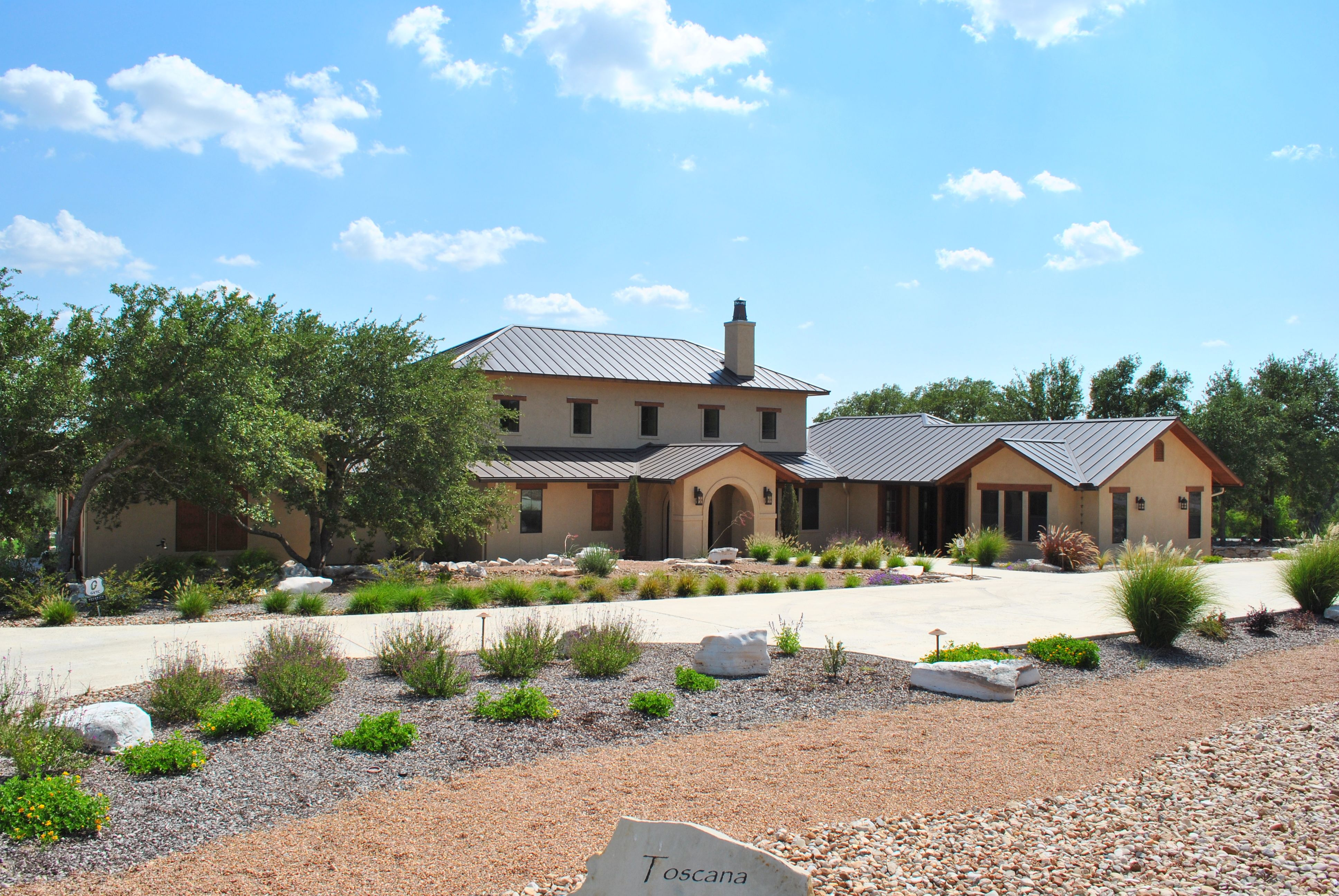 Tuscan Style Home With Stucco Exterior And Metal Roof