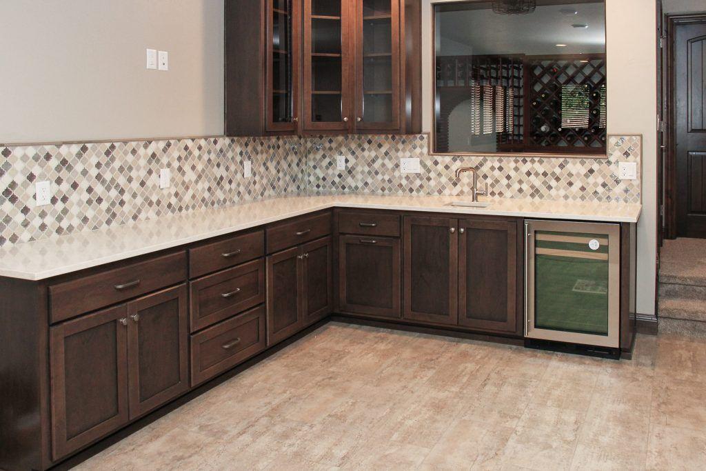 Wet Bar With Tan Luxury Vinyl Tile Flooring And A Tan And Brown Diamond Tile Backsplash Luxury Vinyl Tile Kitchen Tiles Backsplash Luxury Vinyl Tile Flooring