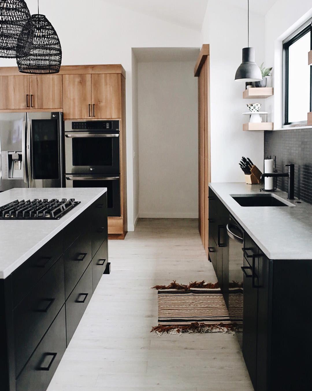 Look How Our Adura Flex Tribeca Vinyl Plank Flooring Helps Elevate This Minimalist Mod Scandinavian Kitchen Design Modern Black Kitchen Kitchen Decor Modern