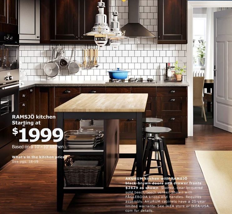 IKEA STENSTORP Kitchen island in oak and black/brown. Keep